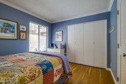 The blue bedroom with queen size bed has lots of closet space