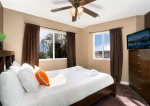 Guest bedroom, ceiling fan, television, curtains