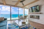 Welcome to Mermaid Crossing at Capri by the Sea. Living room with ocean views, 65 inch flat screen TV and electric fireplace.