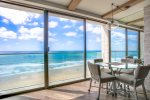 Dine in with spectacular ocean views with seating for 5 using the matching chair from the desk. .