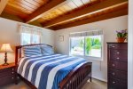 Queen bed, wood beamed ceiling in bedroom too