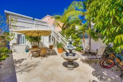 Private fenced back patio between units  to enjoy the lovely ocean breeze and shared garage is available to both