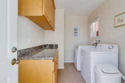 Free laundry room is shared by upper 1BR and lower 2 BR 2 BA unit