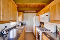 Granite countertops, birch cabinets, and new appliance