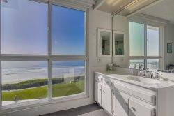 Lovely vanity with ocean views. Fall asleep to the sound of the waves crashing on the shore.
