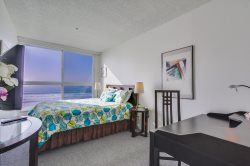 Suite 2 - Queen bed with ocean views.