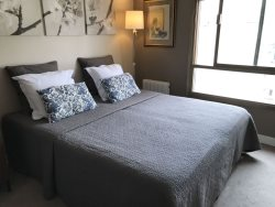 Queen size bed in bedroom, new in April 2018.