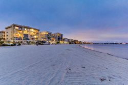 A view of the Riviera Condos at Twilight from the bay and boardwalk