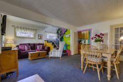 Enjoy family time in the colorful living room after a day at the beach