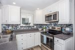 Open California style kitchen fully equipped with everything you need to cook your family a meal.