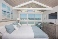 Master bedroom upstairs with King bed, TV, and a magnificent view.