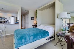 Double sized murphy bed folds down for a comfy nights rest with a view of the sands