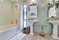 Newly Renovated Bathroom with dual pedestal sinks