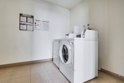 There is coin operated laundry located on every floor of the complex