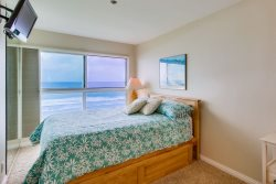 Comfy queen bed with twin trundle - ocean view from room