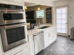Double Ovens and dishwasher in this newly remodeled kitchen