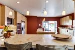 Fully equipped kitchen with center island and 24 inch flat screen TV.