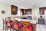 4 breakfast bar chairs at kitchen counter are in addition to dining table for 6.