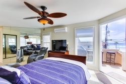 1st Master bedroom suite has queen bed, large HDTV, BlueRay DVD and comfy leather chair.