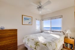 This bedroom has a queen bed, ceiling fan and awesome view.