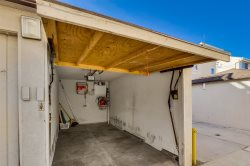 Garage is 17 feet long and 7 feet wide allowing parking for a medium size car.