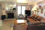 Mammoth Lakes Condo Rental Sunshine Village 175 - Open Living Room with Pellet Stove