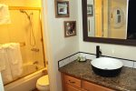 Mammoth Lakes Condo Rental Sunshine Village 175 - Bedroom has 1 Flat Screen TV and Entrance Towards Bathroom
