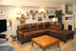 Mammoth Lakes Rental Sunshine Village 175 - Cozy Living Room and Opening Towards Bunk Bed Alcove