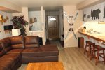 Mammoth Lakes Rental Sunshine Village 175 - Open Living Room Towards Kitchen and Entrance