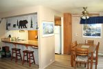 Mammoth Lakes Rental Sunshine Village 175 - Open Living Room Towards Kitchen and Dining Room