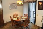 Mammoth Lakes Rental Sunshine Village 167 - Dining Room with Slider to Outside Balcony