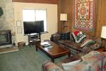 Mammoth Lakes Condo Rental Sunshine Village 168 - Living Room has a Woodstove