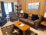 Mammoth Lakes Condo Rental Sunshine Village 134 - Living Room has a Woodstove