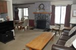 Mammoth Lakes Rental Sunshine Village 103 - Living Room has a Woodstove and 1 Flat Screen TV