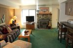Mammoth Lakes Condo Rental Sunshine Village 177 - Open Living Room with Woodstove