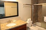 Mammoth Lakes Vacation Rental Sunshine Village 136 - Downstairs Bathroom with New Tile, Granite and Flooring