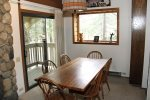 Mammoth Lakes Rental Sunshine Village 138 - Dining Room with Slider to Outside Balcony