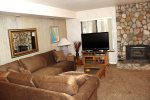 Mammoth Lakes Condo Rental Sunshine Village 165 - Living Room has a Woodstove