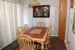 Mammoth Lakes Vacation Rental Sunshine Village 165 - Dining Room with Slider to Outside Balcony