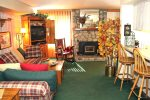 Mammoth Lakes Condo Rental Sunshine Village 113 - Living Room with Woodstove