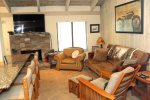 Mammoth Lakes Condo Rental Sunshine Village 148 remodeled unit with large flat screen TV and Queen size Futon Couch Bed which also has 2 pop-up trays to use for dining