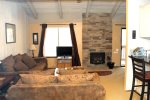Mammoth Lakes Rental Sunshine Village 106 - Open Area Living Room has a woodstove