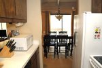 Mammoth Lakes Rental Sunshine Village 106 - Fully Equipped Kitchen Towards Dining Area