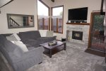 Mammoth Condo Rental Sunrise 1 - Cozy Living Room. View from the Loft. Woodstove and Flat Screen TV