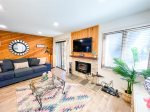 Mammoth Lakes Rental Wildflower 61 - Living Room has a woodburning stove with wood provided on the outside deck
