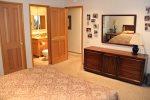 Mammoth Lakes Rental Sunshine Village 166 - Master Bedroom with a King Bed and en suite Bathroom