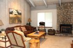 Mammoth Lakes Rental Sunshine Village 166 - Cozy Living Room has a Woodstove and a Queen Sofa Sleeper