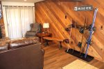 Mammoth Condo Rental Wildflower 41: Living room with Equipment Storage and Access to a Private Deck