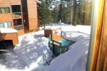 Mammoth Condo Rental Mountainback 19- Living Room with a Large Flat Scree TV and Woodburing Stove
