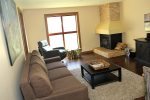 Mammoth Condo Rental Aspen Creek 117: Living Room with queen sofa sleeper, wood burning fireplace, large bright windows
